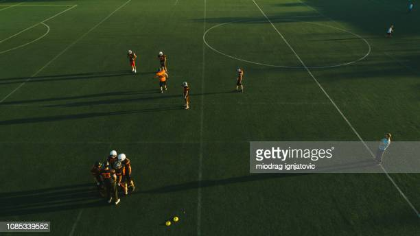 football team playing a game - rush american football stock pictures, royalty-free photos & images