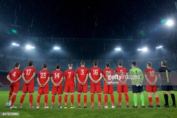 football team standing in a row - football strip stock pictures, royalty-free photos & images