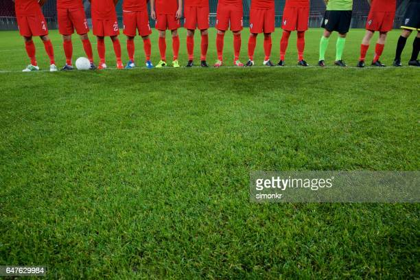 Football team standing in a row