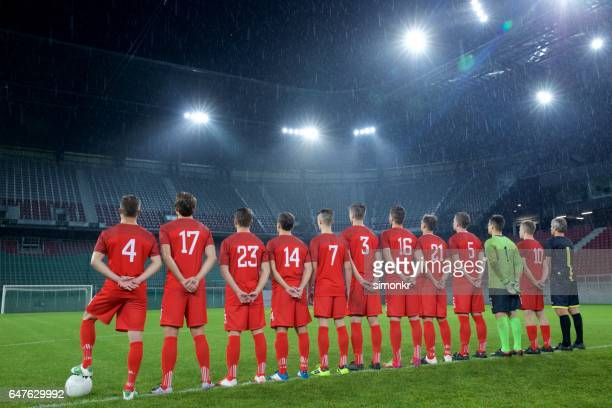 football team standing in a row - football team stock pictures, royalty-free photos & images