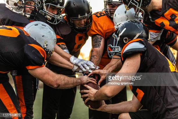 football team starting match - american football sport stock pictures, royalty-free photos & images