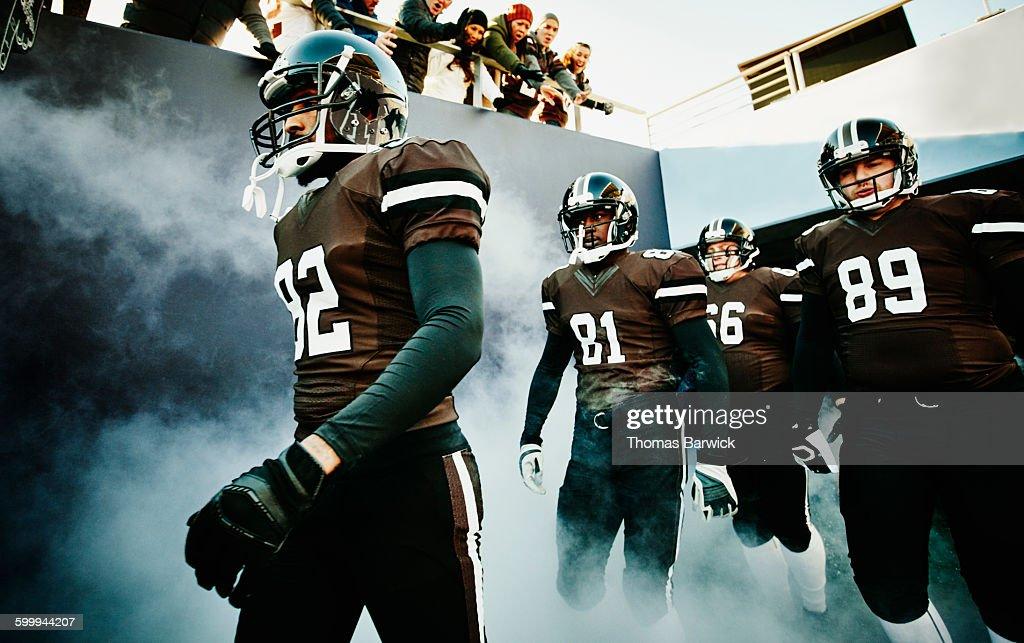 Football team walking out of stadium tunnel : Stock Photo