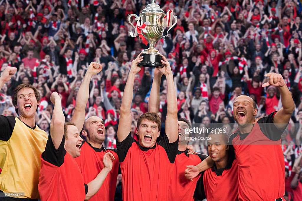 Football team winning a trophy : Stock Photo