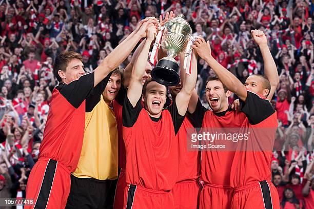 Football team winning a trophy
