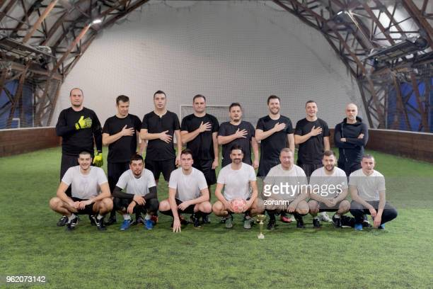football teams posing with cup - soccer team stock pictures, royalty-free photos & images