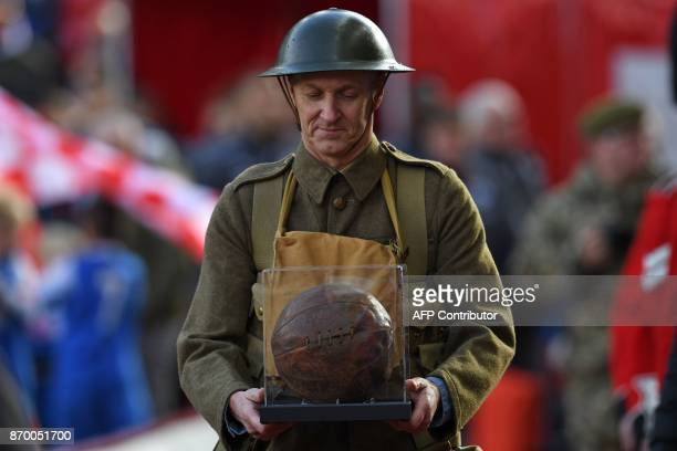A football that was played with by troops before the battle of the Somme in world war one is displayed during the pregame Remembrace Day activities...