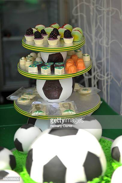 Football themed cakes on sale at the Brazil day party in Trafalgar Square on June 12 2014 in London England The 20th FIFA Football World Cup kicks...