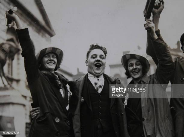 Football Three enthusiastic fans of the Huddersfield Club before the cup final against Arsenal FC London 1930 Photograph