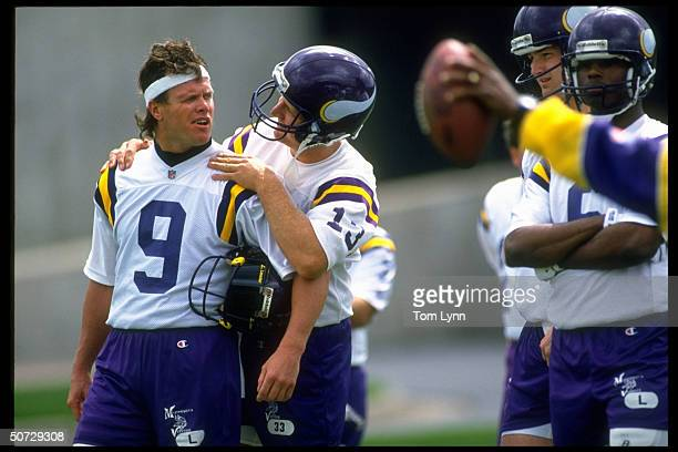 Training Camp Minnesota Vikings Jim McMahon w #13 Gino Torretta on the sidelines