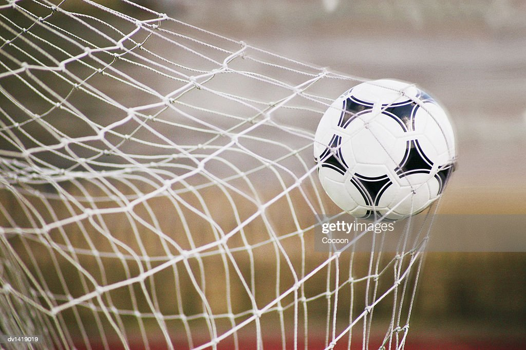 Football Trapped in a Goal Net, Close-Up : Stock Photo