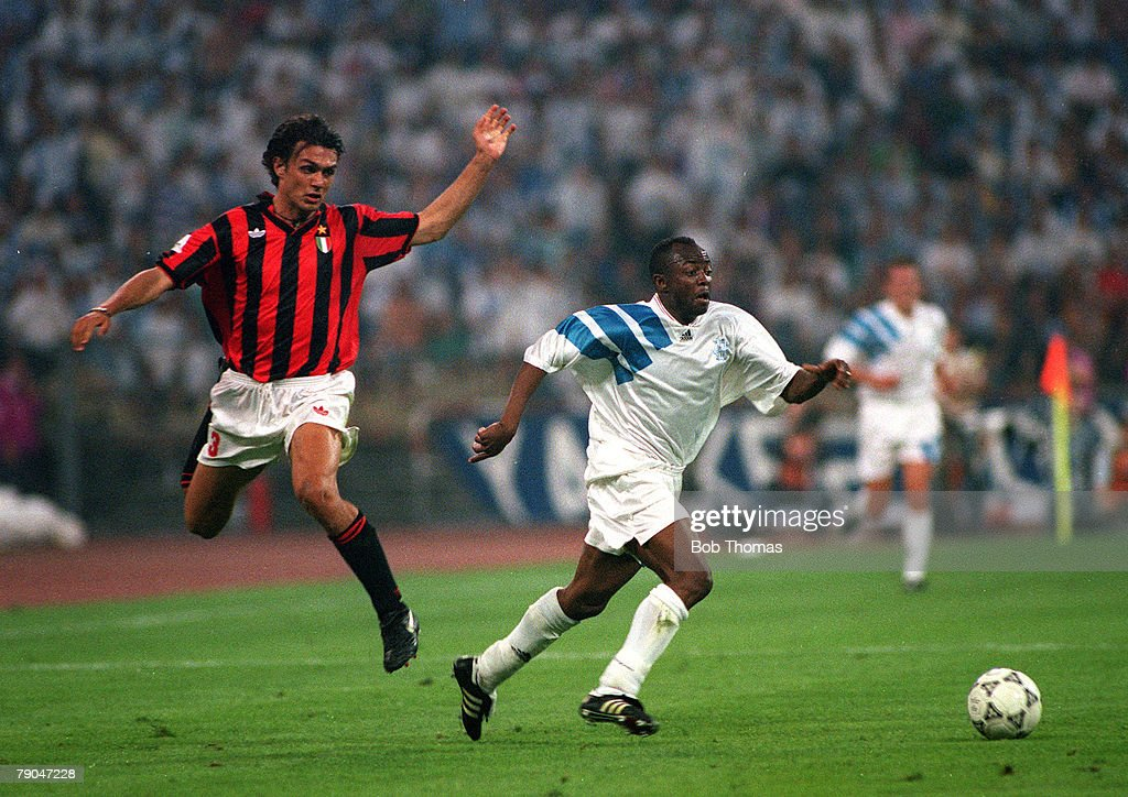 Football. UEFA Champions League Final. Munich, Germany. 26th May 1993. Marseille 1 v AC Milan 0. Marseille's Abedi Pele beats AC Milan's Paolo Maldini. : News Photo