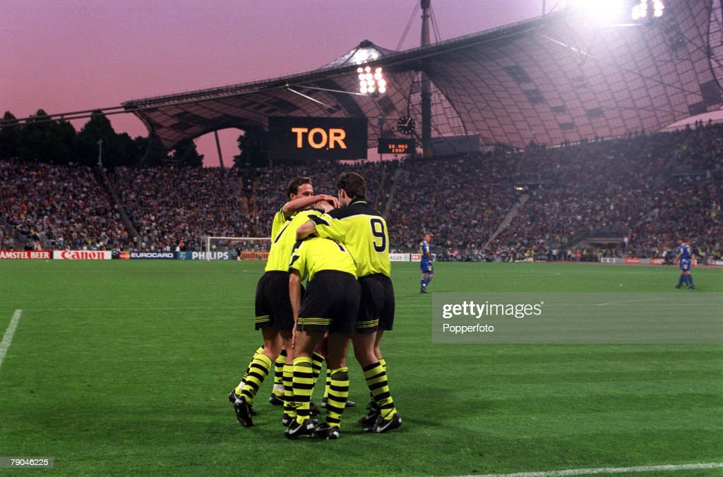 Football. UEFA Champions League Final. Munich, Germany. 28th May 1997. Borussia Dortmund 3 v Juventus 1. Borussia Dortmund's Karlheinz Riedle is congratulated by his team-mates after scoring his side's second goal, as the scoreboard in the background disp : News Photo