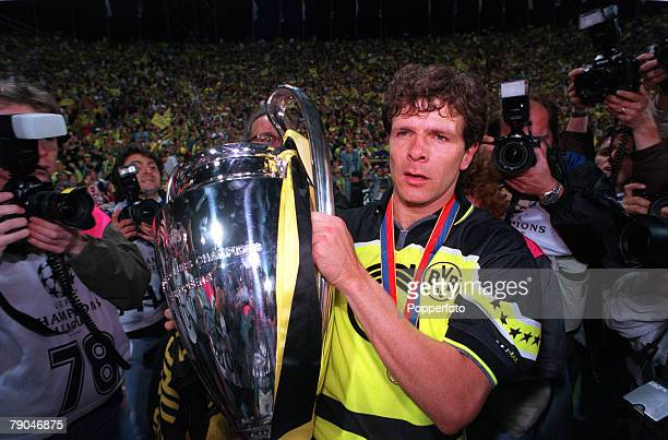 Football UEFA Champions League Final Munich Germany 28th May 1997 Borussia Dortmund 3 v Juventus 1 Borussia Dortmund's Andreas Moller holds the...