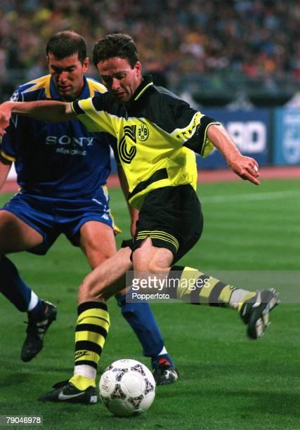 Football UEFA Champions League Final Munich Germany 28th May 1997 Borussia Dortmund 3 v Juventus 1 Borussia Dortmund's Paul Lambert is closely...