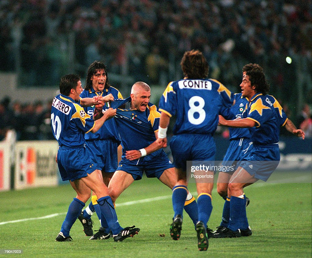 Football. UEFA Champions League Final. Rome, Italy. 22nd May 1996. Juventus 1 v Ajax 1 (after extra time, Juventus win 4-2 on penalties). Fabrizio Ravanelli of Juventus (centre) celebrates with his team-mates after scoring his sides goal. : News Photo