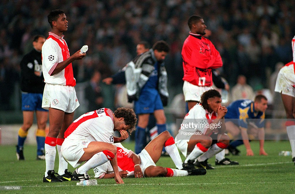 Football. UEFA Champions League Final. Rome, Italy. 22nd May 1996. Juventus 1 v Ajax 1 (after extra time, Juventus win 4-2 on penalties). Danny Blind of Ajax cannot watch with his team-mates during the penalty shoot-out. : News Photo