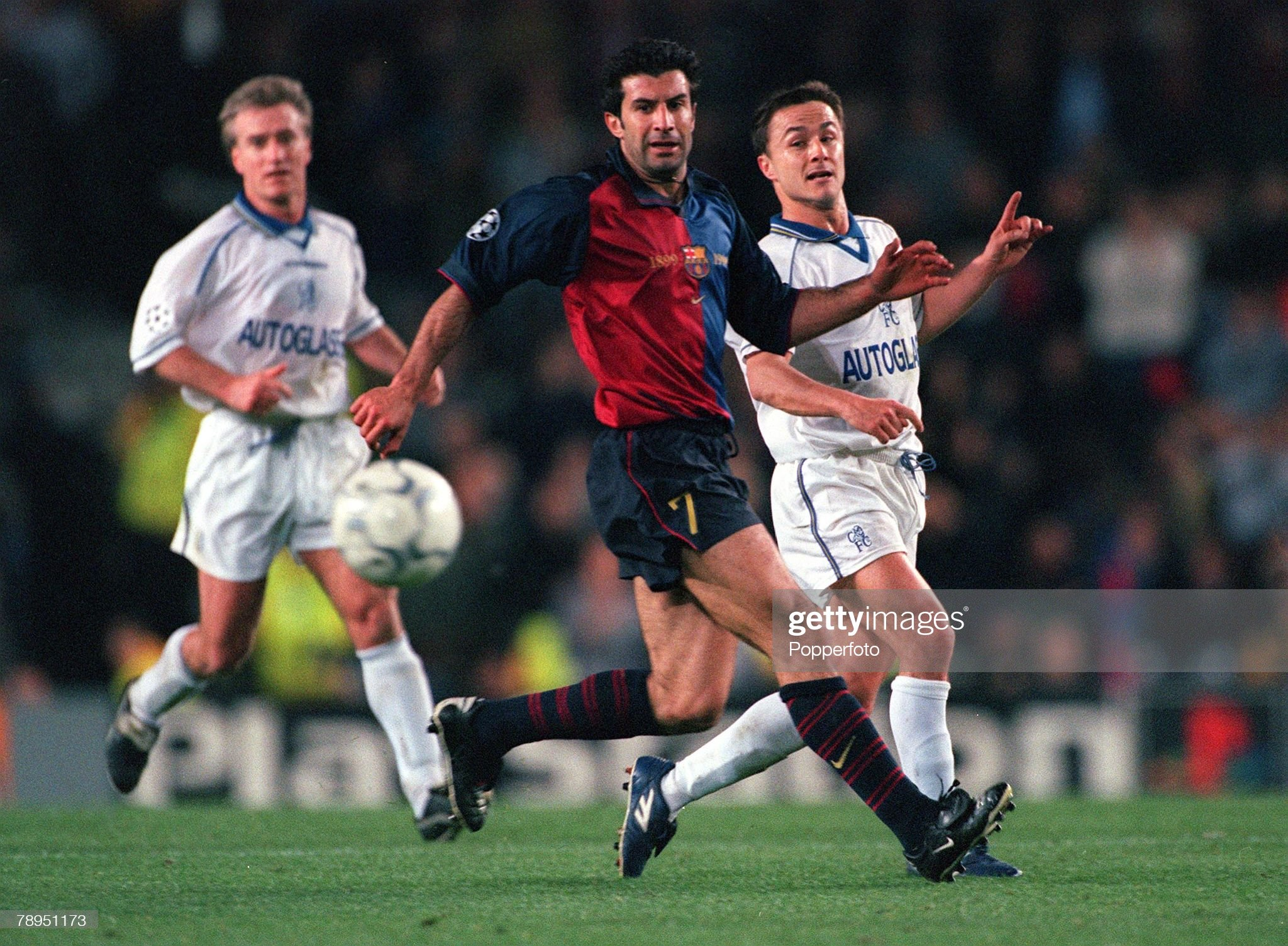 Football. UEFA Champions League. Quarter-final, 2nd leg. Nou Camp, Spain. 18th April 2000. Barcelona 5 v Chelsea 1. Barcelona's Luis Figo, is challenged by Chelsea's captain Dennis Wise. : News Photo