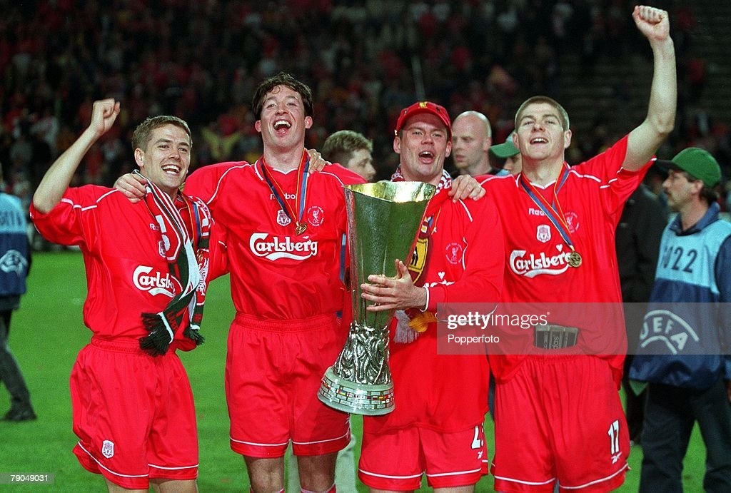 Football. UEFA Cup Final. 16th May 2001. Dortmund, Germany. Liverpool 5 v Deportivo Alaves 4 (on Golden Goal). Liverpool quartet L-R: Michael Owen, Robbie Fowler, Jamie Carragher, and Steven Gerrard are pictured with the trophy during the celebrations. : News Photo