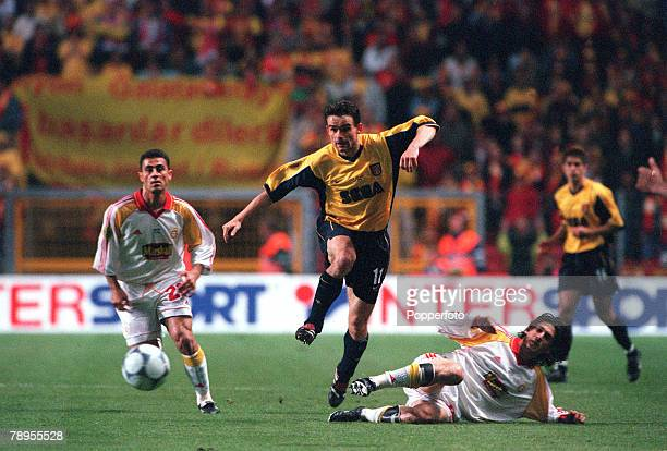 Football UEFA Cup Final 17th May Copenhagen Denmark Galatasaray bt Arsenal 41 on penalties Arsenal's Marc Overmars beats Hasan Sas and Davala Umit of...
