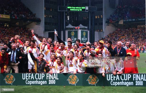 Football UEFA Cup Final 17th May Copenhagen Denmark Galatasaray bt Arsenal 41 on penalties The victorious Galatasaray side celebrate with the trophy