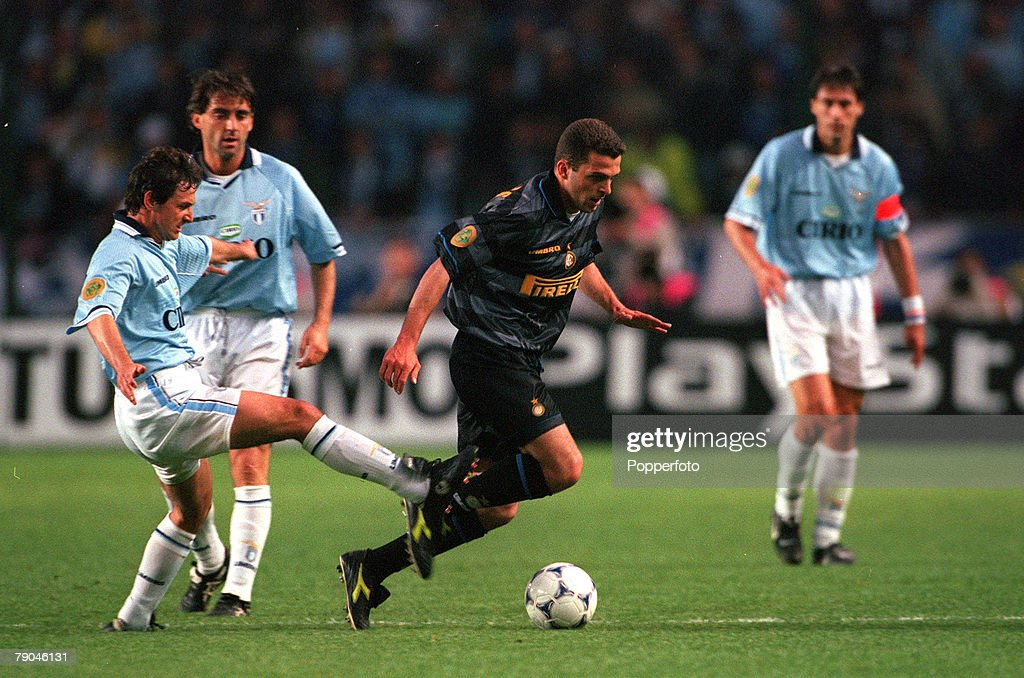 Football. UEFA Cup Final. Paris, France. 6th May 1998. Inter Milan 3 v Lazio 0. Inter Milan's Ze Elias moves past a reckless challenge from Lazio's Giorgio Venturin. : News Photo