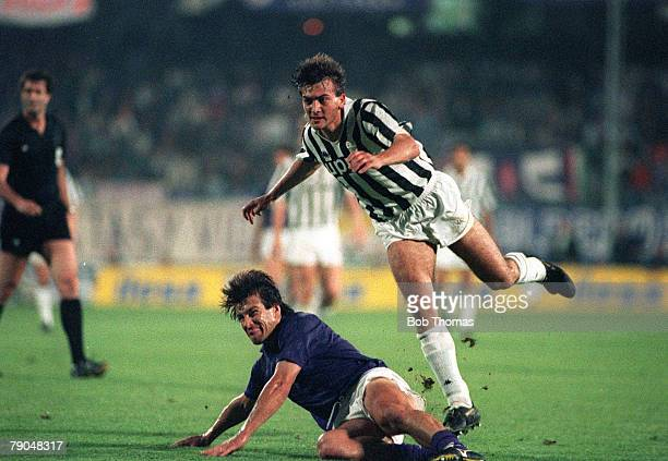 Football UEFA Cup Final Second Leg Florence Italy 16th May 1990 Fiorentina 0 v Juventus 0 Fiorentina's Carlos Dunga slides to tackle Pierluigi...