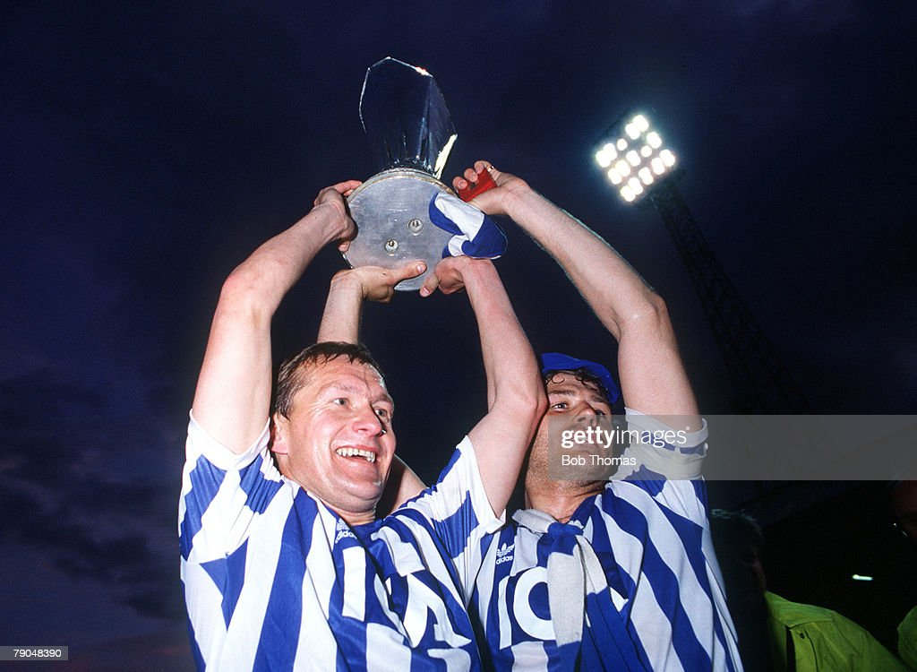 Football. UEFA Cup Final, Second Leg. Tannadice Park, Scotland. 20th May 1987. Dundee United 1 v IFK Gothenburg 1 (Gothenburg win 2-1 on aggregate). Gothenburg's Stig Fredriksson (left) and captain Glenn Hysen hold the trophy aloft. : News Photo