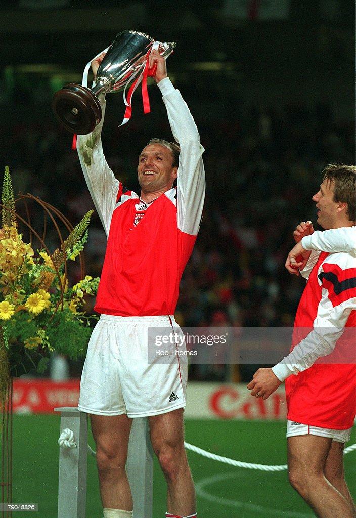 Football. UEFA Cup Winners Cup Final. Copenhagen, Denmark. 4th May 1994. Arsenal 1 v Parma 0. Arsenal's Steve Bould holds the trophy aloft. : News Photo