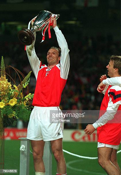 Football, UEFA Cup Winners Cup Final, Copenhagen, Denmark, 4th May 1994, Arsenal 1 v Parma 0, Arsenal's Steve Bould holds the trophy aloft