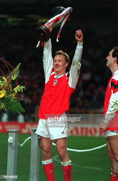 Football, UEFA Cup Winners Cup Final, Copenhagen, Denmark, 4th May 1994, Arsenal 1 v Parma 0, Arsenal's Lee Dixon holds the trophy aloft