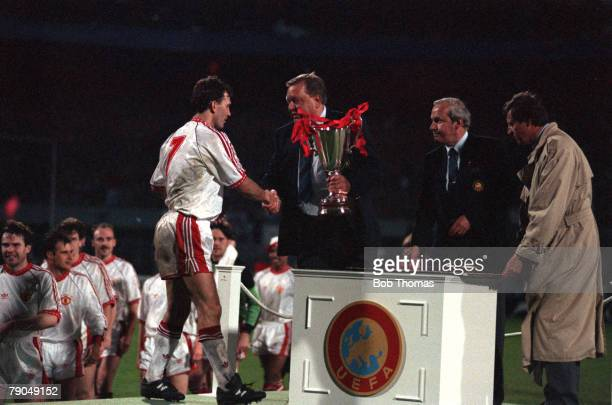 Football UEFA Cup Winners Cup Final Rotterdam Holland 15th May 1991 Manchester United 2 v Barcelona 1 Manchester United captain Bryan Robson receives...