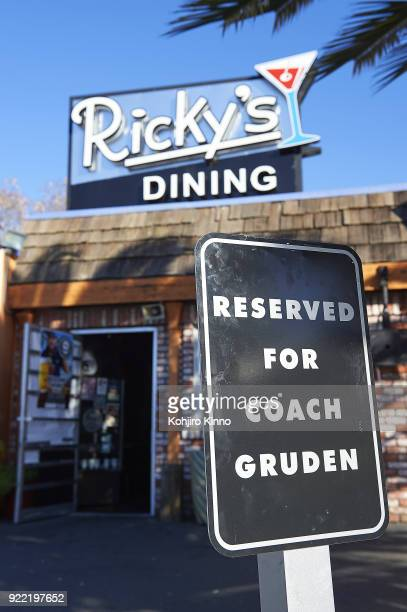 View exterior and awning for Ricky's Dining with parking sign reading RESERVED FOR COACH GRUDEN in honor of Oakland Raiders head coach Jon Gruden at...