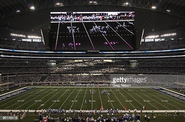 View of Cowboys Stadium HD scoreboard during Dallas Cowboys vs Tennessee Titans preseason game Tennessee Titans AJ Trapasso hit HD screen which is...