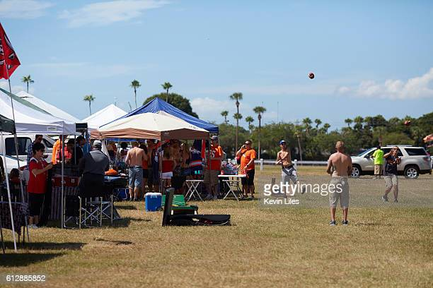 View of Denver Bronocs fans tailgating in parking lot before game vs Tampa Bay Buccaneers outside of Raymond James Stadium Tampa FL CREDIT Kevin Liles