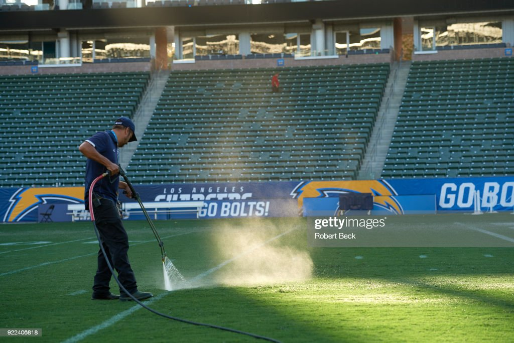 View of grounds crew working on field before Los Angeles Chargers vs Philadelphia Eagles at StubHub Center. Robert Beck TK1 )