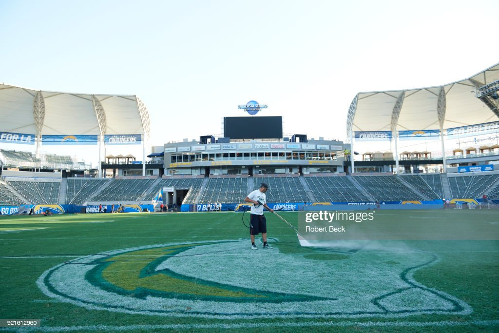 View of grounds crew working on team logo on field before Los Angeles Chargers vs Philadelphia Eagles at StubHub Center. Robert Beck TK1 )