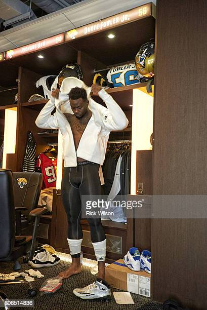 View of Jacksonville Jaguars defensive end Dante Fowler changing in locker room before game vs Green Bay Packers at Everbank Field Jacksonville FL...