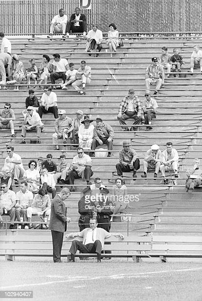 View of Oakland Raiders coach Al Davis sitting on sidelines bench before game vs Buffalo Bills Oakland CA 9/15/1963 CREDIT Curt Gunther