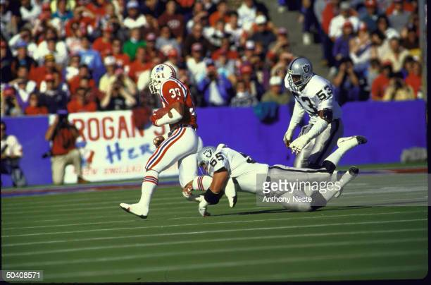 View of LA Raiders Matt Millen in action vs New England Patriots Mosi Tatupu.