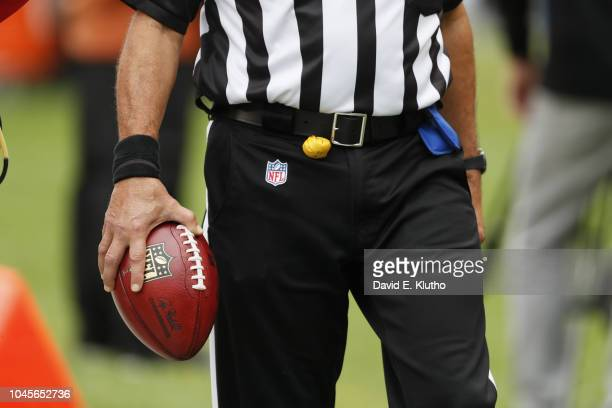 View of referee holding football in hand and penalty flag on waist during Chicago Bears vs Tampa Bay Buccaneers game at Soldier Field. Equipment....