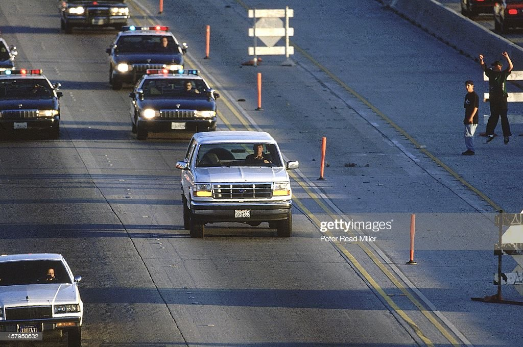 View of white Ford Bronco being driven by Al Cowling on Interstate 405. Former NFL running back O.J. Simpson hiding in the car after failing to turn himself in for the murder of his ex-wife. Peter Read Miller F13 )