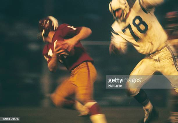 Washington Redskins QB Dick Shiner in action under pressure vs Baltimore Colts John Diehl at Memorial Stadium Baltimore MD CREDIT Neil Leifer