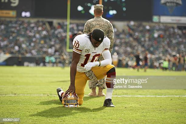 Washington Redskins QB Robert Griffin III down on one knee before game vs Philadelphia Eagles at Lincoln Financial Field Philadelphia PA CREDIT...