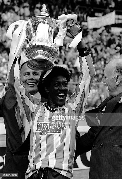 Football Wembley Stadium England FA Cup Final 16th May 1987 Coventry City 3 v Tottenham Hotspur 2 Coventry's Dave Bennett proudly holds aloft the...