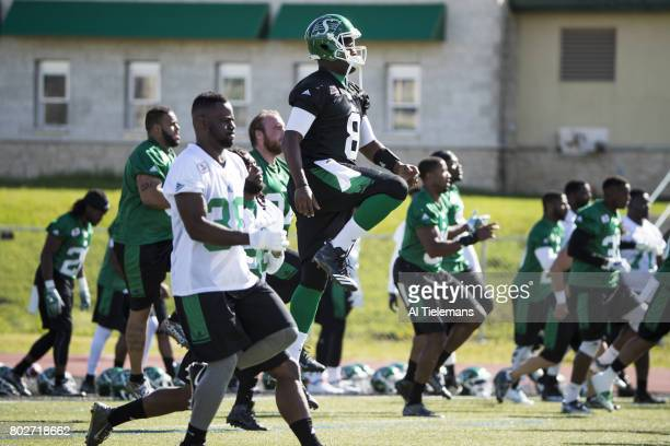 Where Are They Now Former NFL QB and current Saskatchewan Roughriders QB Vince Young working out with teammates during practice Saskatoon Canada...