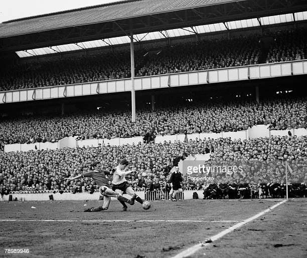 Football White Hart Lane London England 21st March 1964 Tottenham Hotspur v Manchester United Tottenham Hotspur's Jimmy Robertson is tackled by...