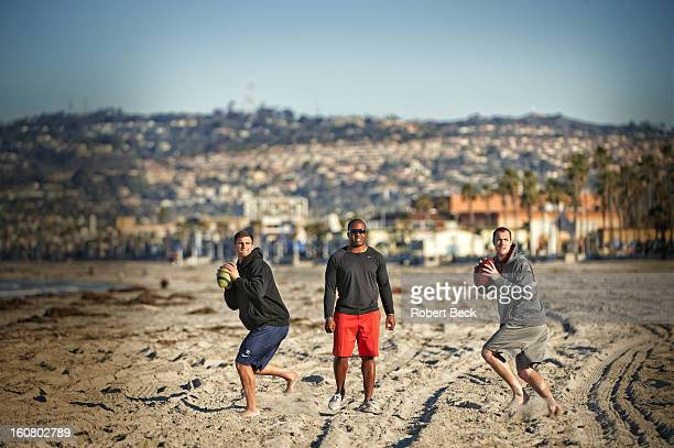 Whitfield Athletix director George Whitfield Jr coaches quaterbacks Landry Jones and Johnny McEntee during workout at Mission Beach San Diego CA...