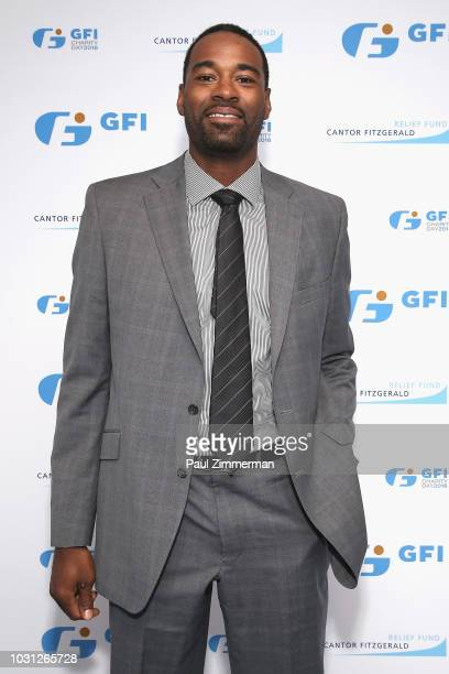 Football wide receiver Calvin Johnson attends the Annual Charity Day hosted by Cantor Fitzgerald BGC and GFI at GFI Securities on September 11 2018...