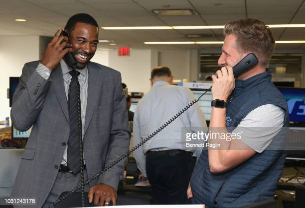 Football wide receiver Calvin Johnson places a trade on the phone during Annual Charity Day hosted by Cantor Fitzgerald BGC and GFI at GFI Securities...