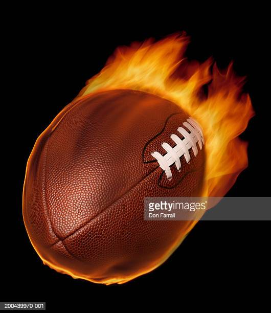 Football with flames, close-up (digital composite)